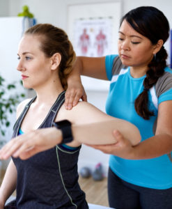 Physiotherapist assessing shoulder motion